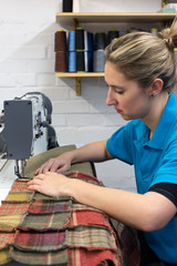Machinist sewing in a furnishings company.
