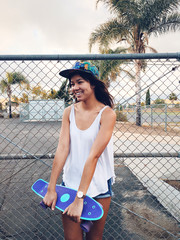 Pretty Asian skater girl with a hat