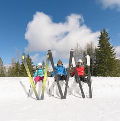Friends on the ski slope taking a break
