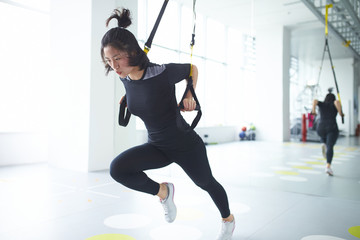 young asian woman in gym