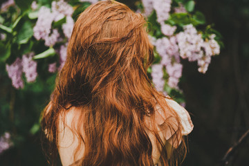 Back view on anonymous woman with redhair