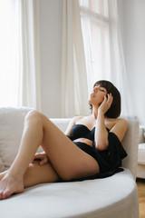 Indoor Portrait of Sensual Caucasian Brunette in Black Underwear