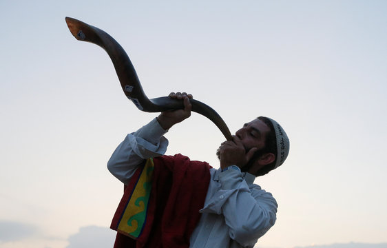 An ultra-Orthodox Jewish pilgrim blows a shofar, near the tomb of Rabbi Nachman of Breslov during the celebration of Rosh Hashanah holiday, the Jewish New Year, in Uman
