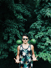 Man Tossing Watermelons