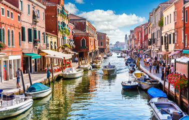 Island murano in Venice Italy. View on canal with boat Fototapete