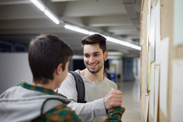 Two young students congratulating the grades of the university