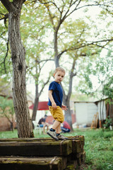 Boy is playing outside