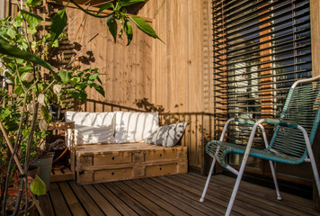 Wooden pallet couch on balcony