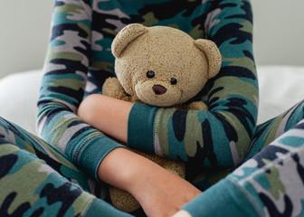 Boy holding his Teddy Bear