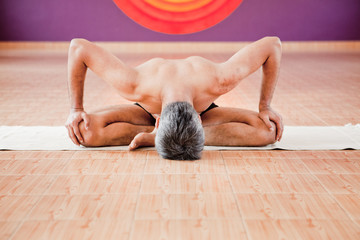 Man doing yoga in a studio
