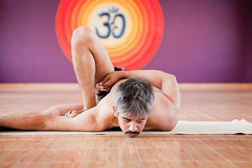 Man doing yoga in a studio