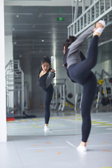 young asian woman stretch her body in the gym
