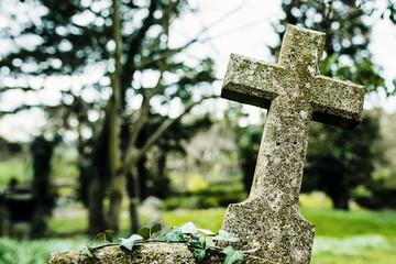 Cross gravestone in a graveyard