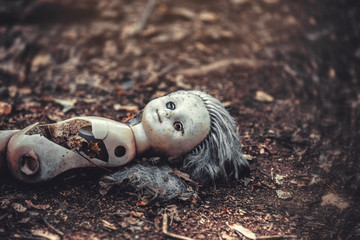 A broken doll in an abandoned kindergarten in the village of Kopachi, Chernobyl District, a zone of alienation