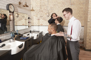 Barber cutting client's hair.