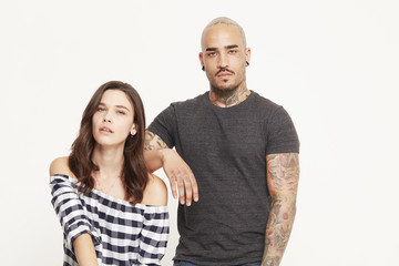 Young woman and tattooed young man