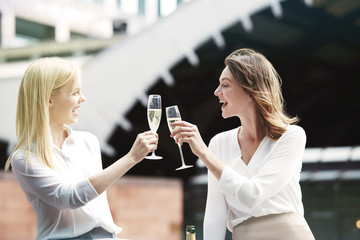 Young women toasting with champagne.