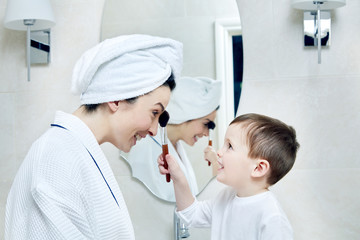 son applying mother's make-up
