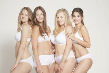 Young women posing in underwear, real women