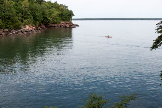 Silhouette of a kayaker on scenic Madeline Island in Lake Superior