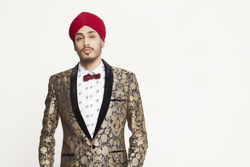 Young man wearing red turban and bow tie