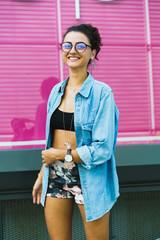 Stylish content girl posing at street