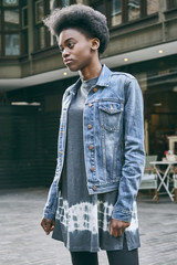 Teenage girl wearing denim jacket