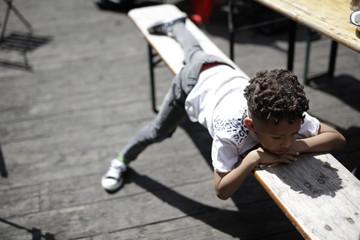 Boy lying down on bench