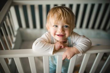 Portrait of baby girl in cot