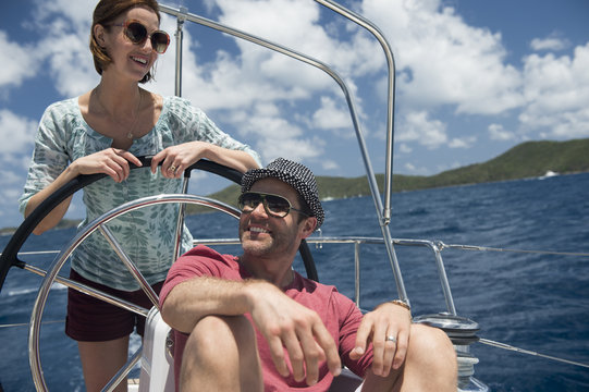 Couple sailing yacht at sea