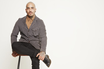 Bald young man with tattoos