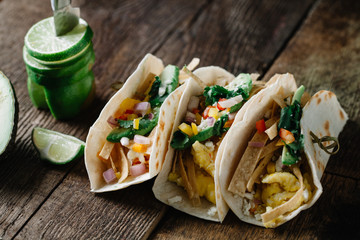 Breakfast tacos with eggs, avocado and fresh cut vegetables