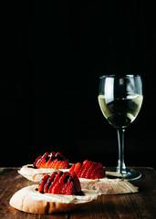 Tasty bruschetta with fresh strawberries, baked brie cheese and balsamic vinegar