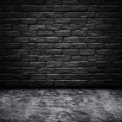 Dark room with black brick wall