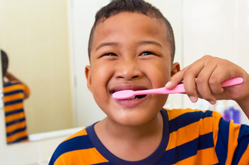 Asian boy brushing teeth in bathroom with tooth brush healthy lifestyle,child dental care.