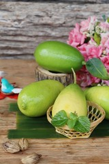 Fresh lemon on wood background