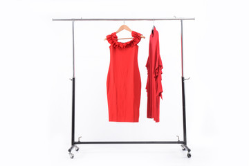 female two red dress on hanger on wooden background