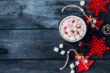 Holiday Background with Hot Chocolate with Marshmallow and Holiday Decoration. Traditional Winter Christmas Drink. Copy Space Top view