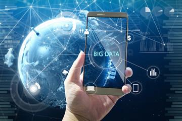 "Man using digital device with ""BIG DATA"" word on digital virtual screen . Hi-tech business concept ."