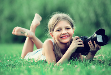 girl lying in park with camera