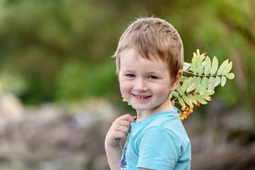 Portrait of a happy little boy outdoors. Summer portrait