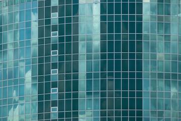 Fassade eine Hotelhochhauses aus Glas mit elliptischer Grundform und spitz zulaufenden Enden, Facade a high-rise of glass with elliptical basic shape and pointed ends with hotel