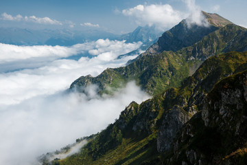 Beautiful clouds and fog among mountain landscape.