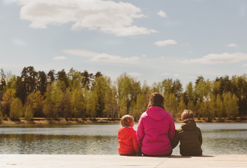 mother with two kids looking at autumn nature