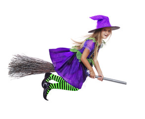 Happy girl in a witch halloween fancy dress flying on the broom in a white studio
