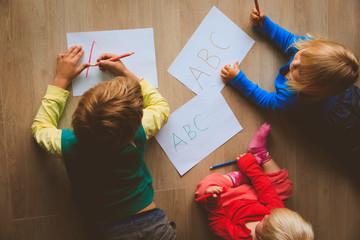 kids write letters, do homework