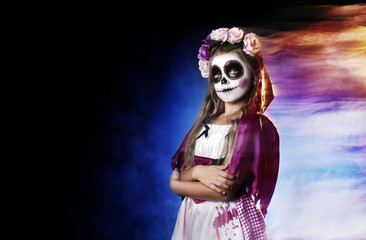 Little girl  wearing Halloween santa muerte outfit