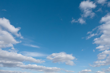 White clouds and blue sky. Blue sky with clouds over horizon.