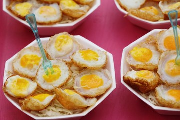 Quail eggs with sauce in street food