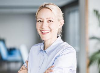 Portrait of happy businesswoman in office